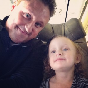 Daddy and Ava on plane ready to fly
