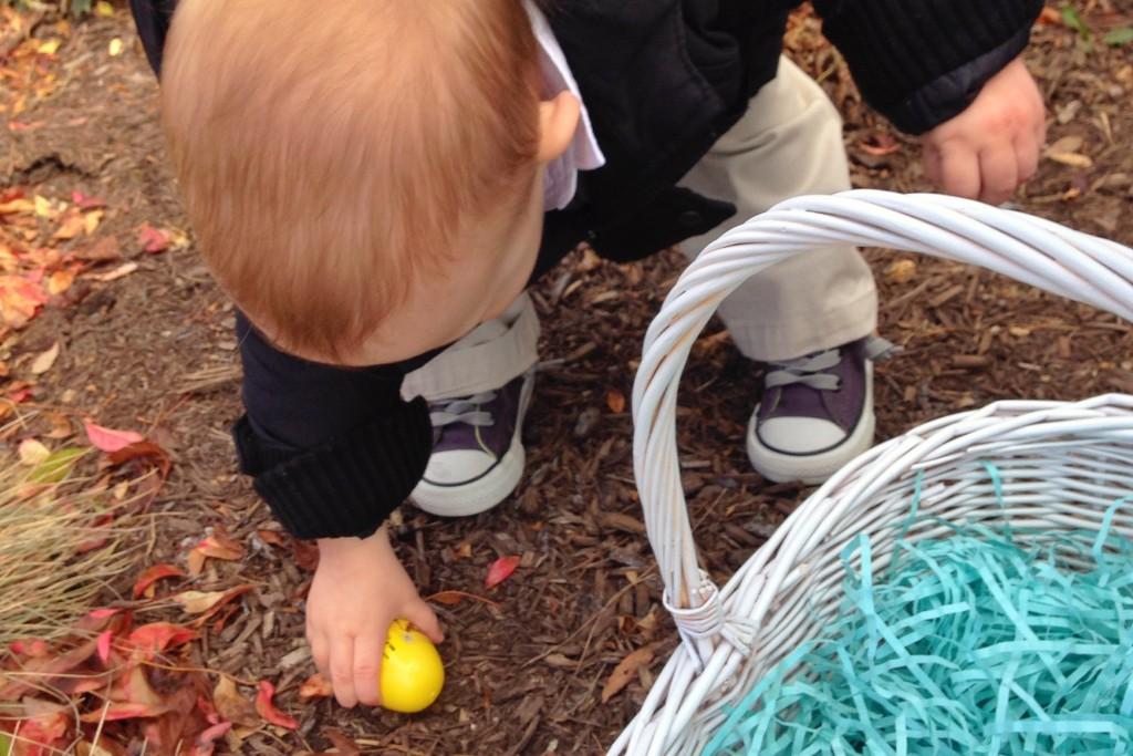 Mason picking up Easter eggs