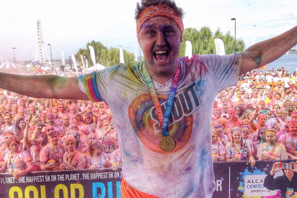 Adrian on stage at Color Run