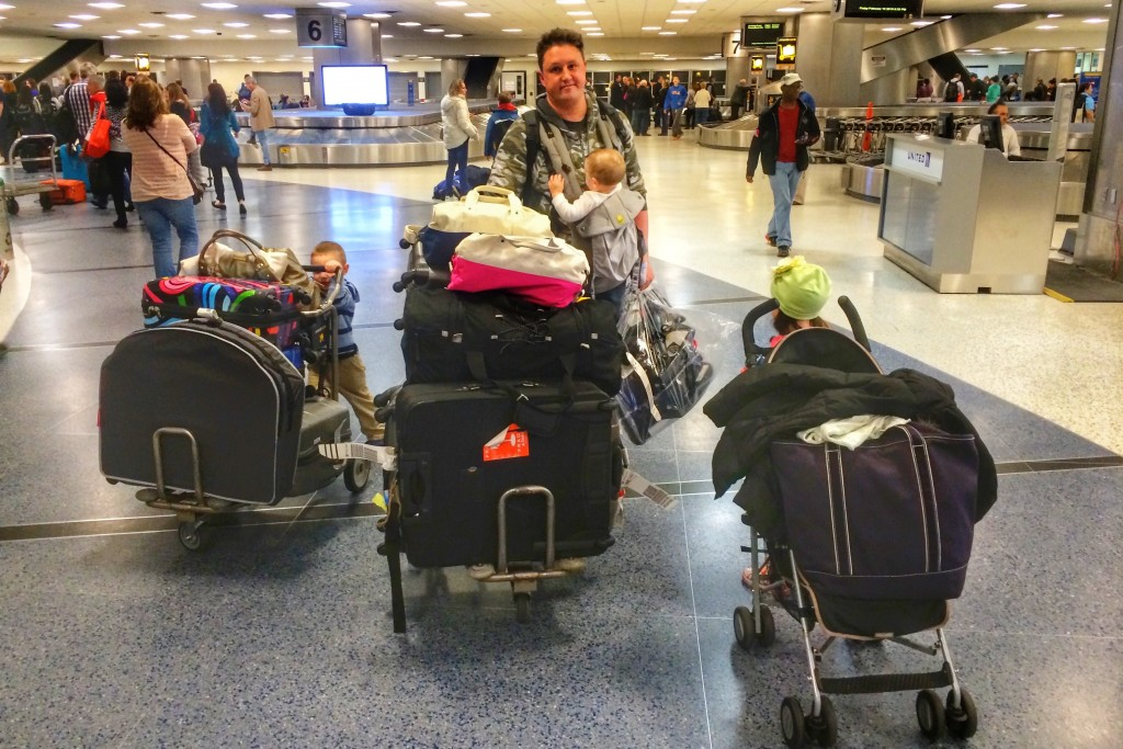 Dad pushes luggage through DFW airport