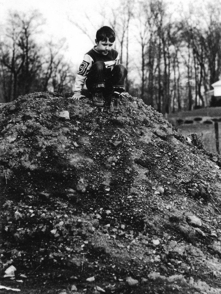 Adrian climbs the dirt hill