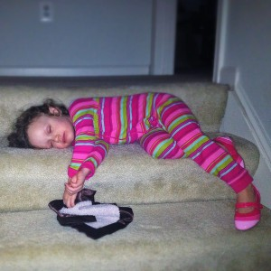 Ava sleeping on the stairs