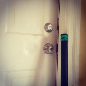 Adrian busts down door