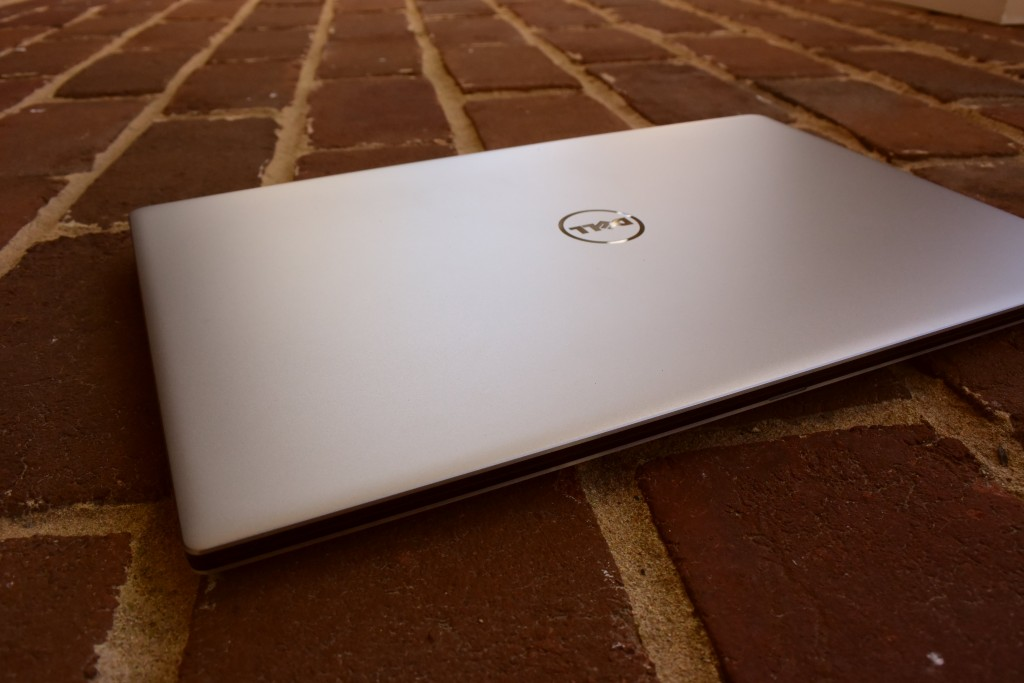 DELL XPS CLOSED ON BRICK