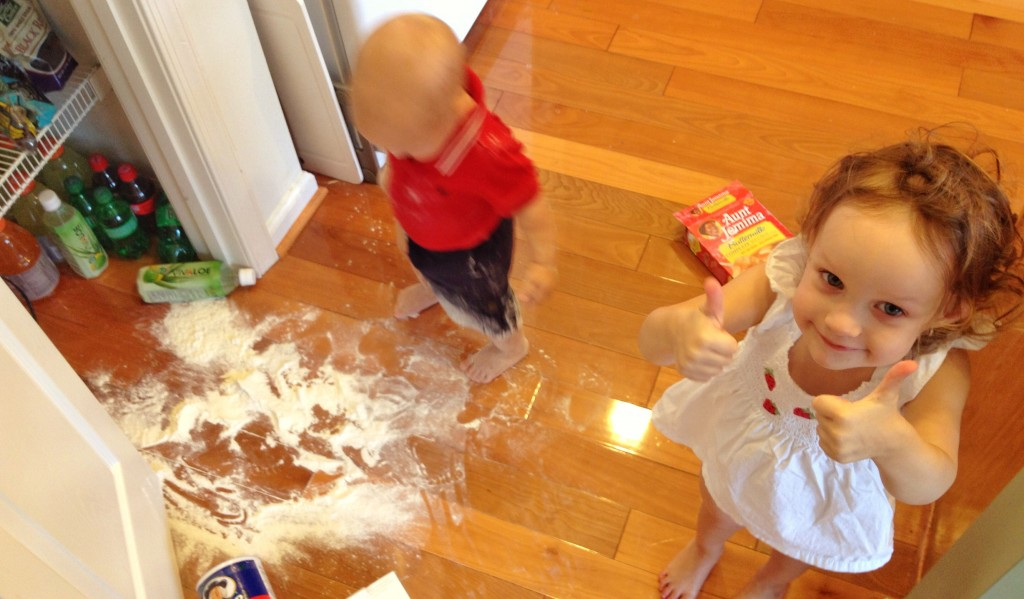 Ava thumbs up for Charlie spilling flour