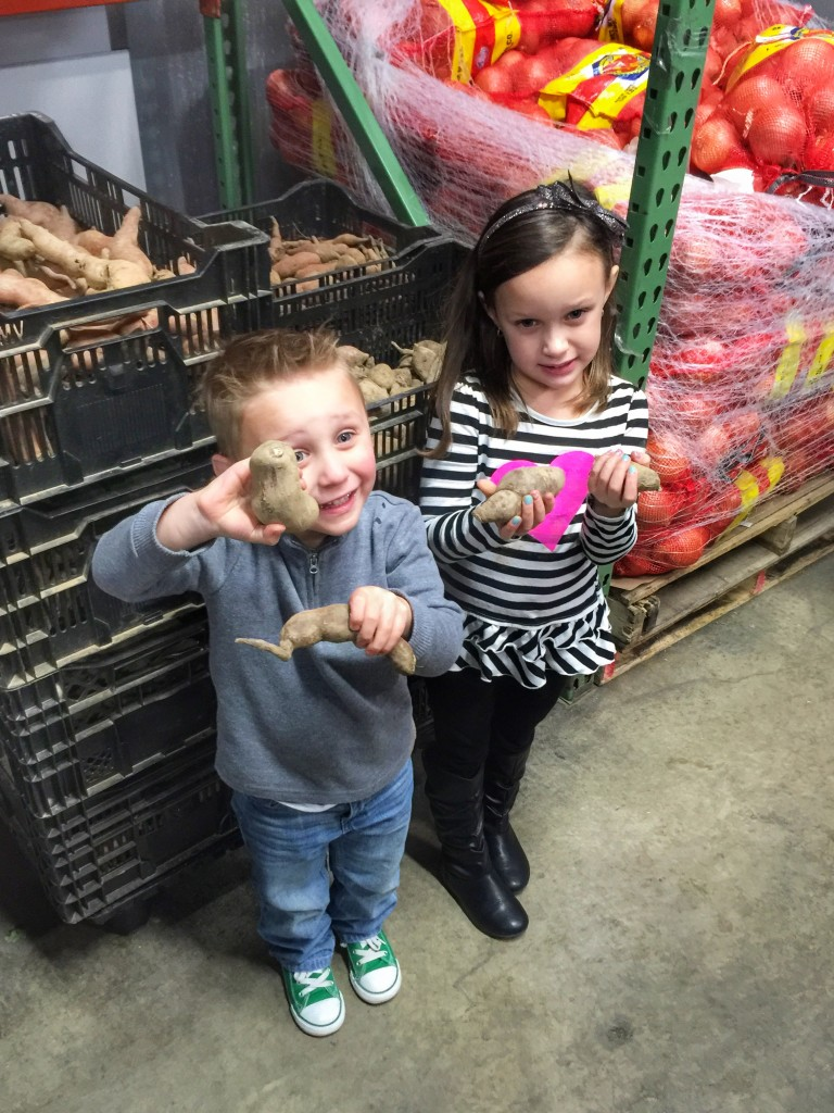 Ava and Charlie with sweet potatoes