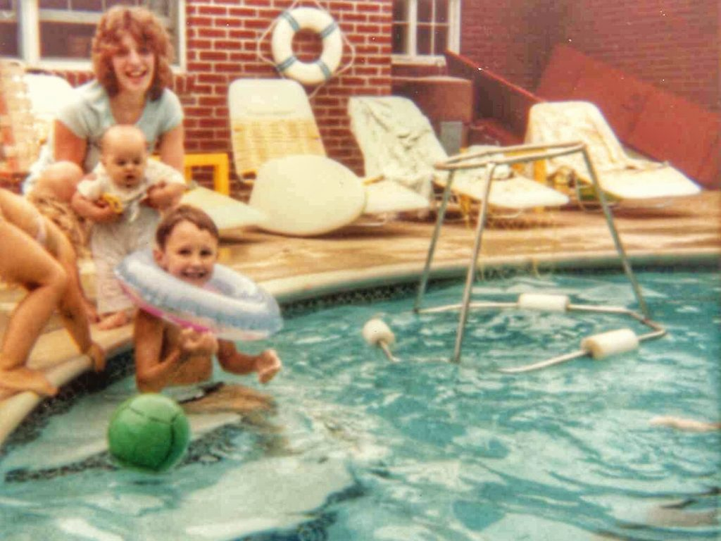 Adrian in the pool with Aunt Beth 1981